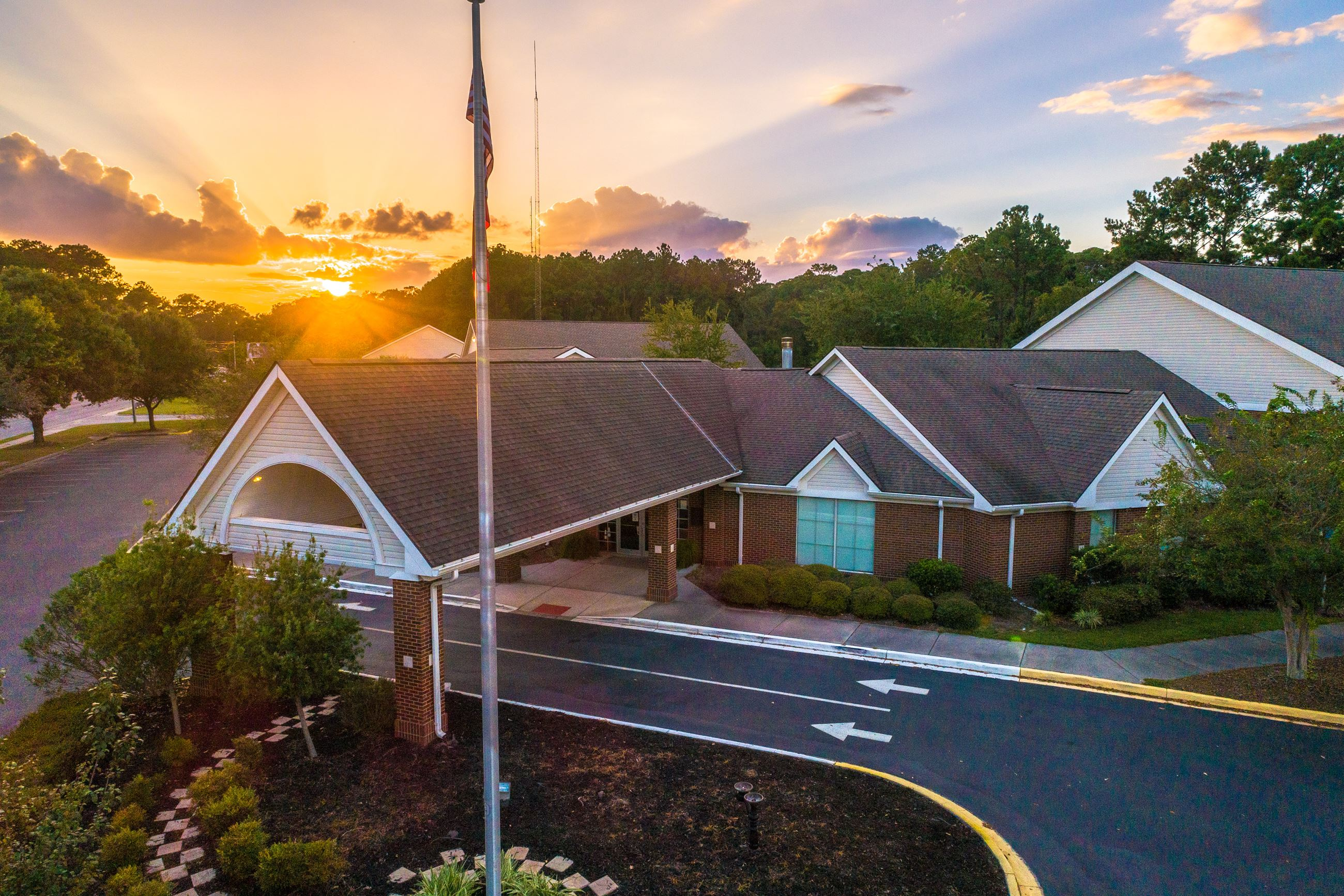 An image of the VLPRA senior center building with the sunset in the background.