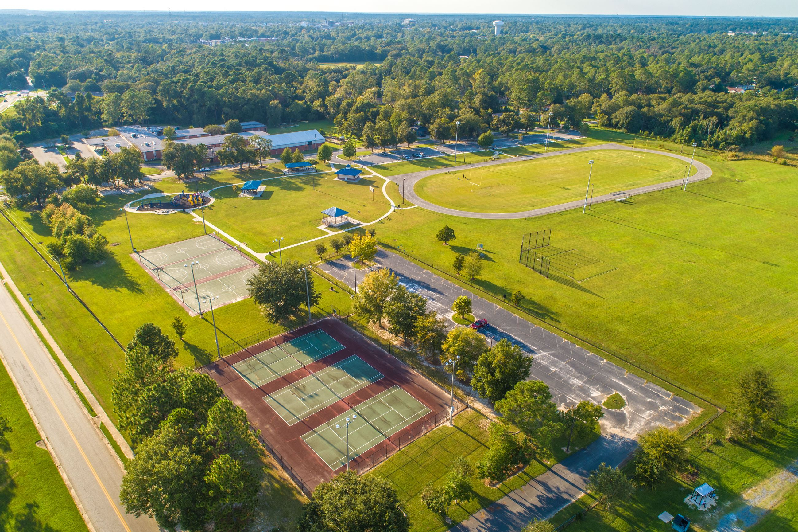 Image showing an aerial view of tennis courts and basketball courts.