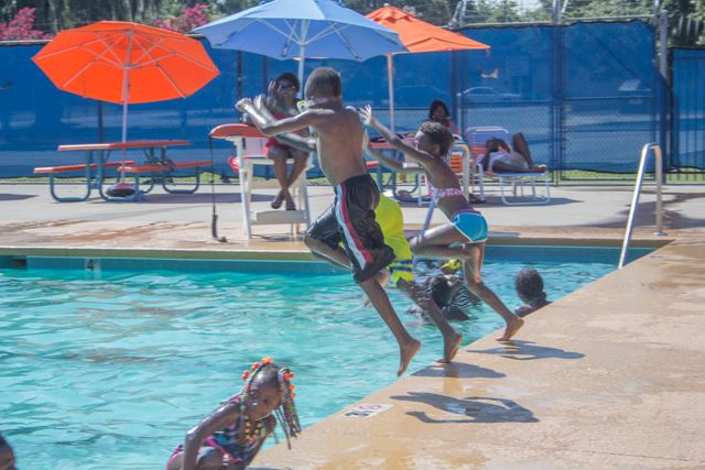 Image of children jumping into pool.