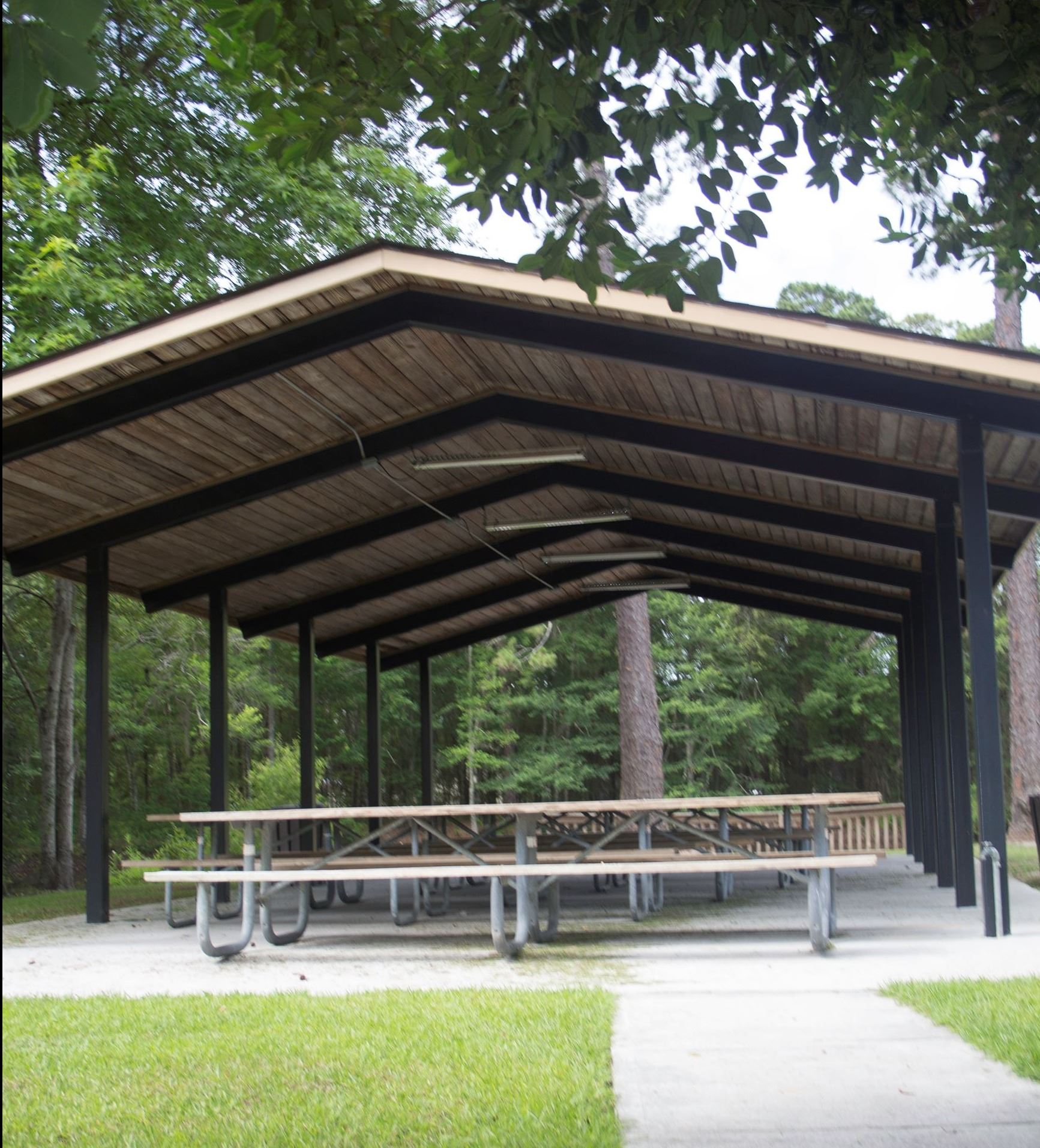 An image of a picnic shelter with picnic tables.