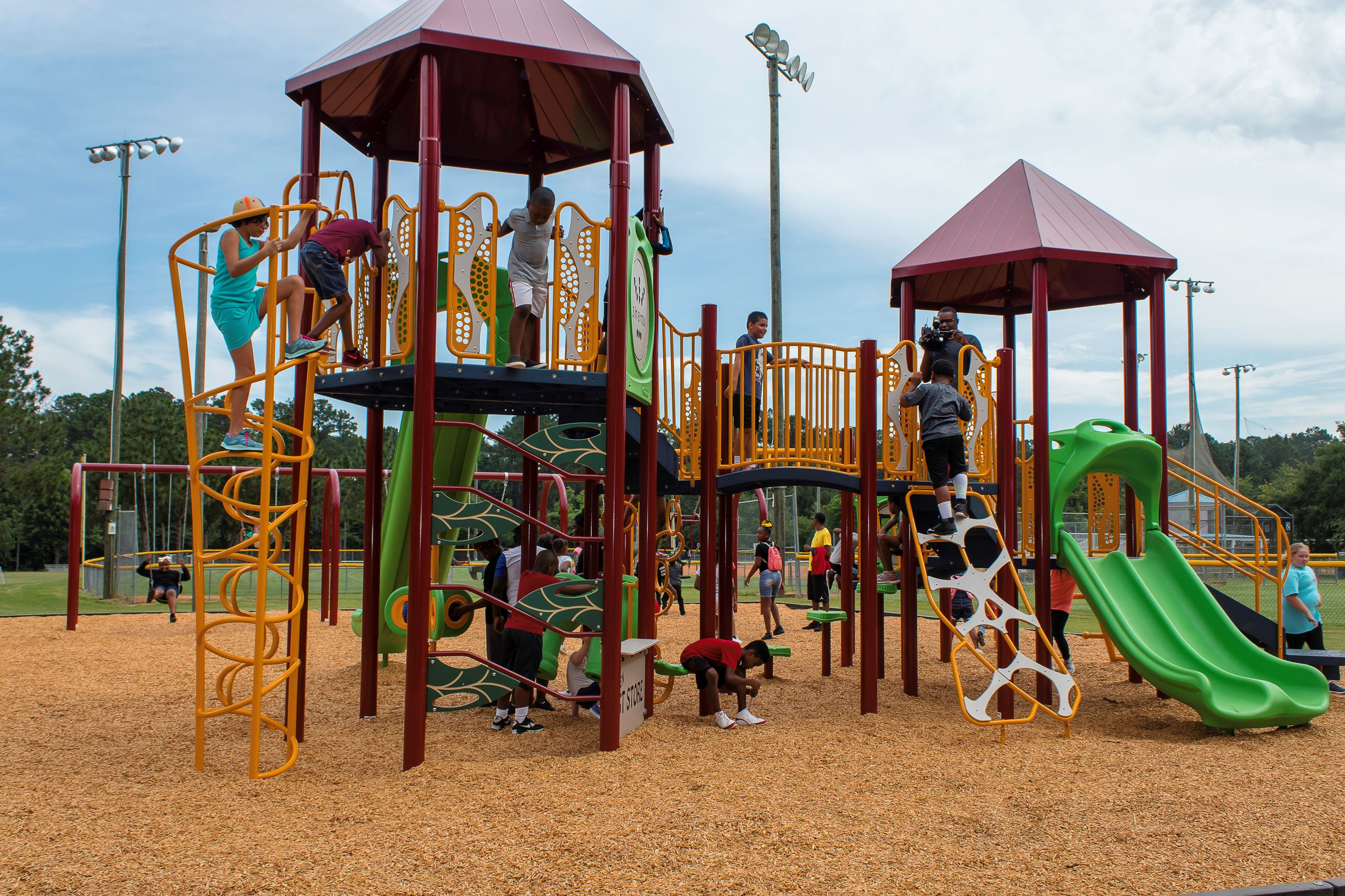 An image of children playing on a large play structure.