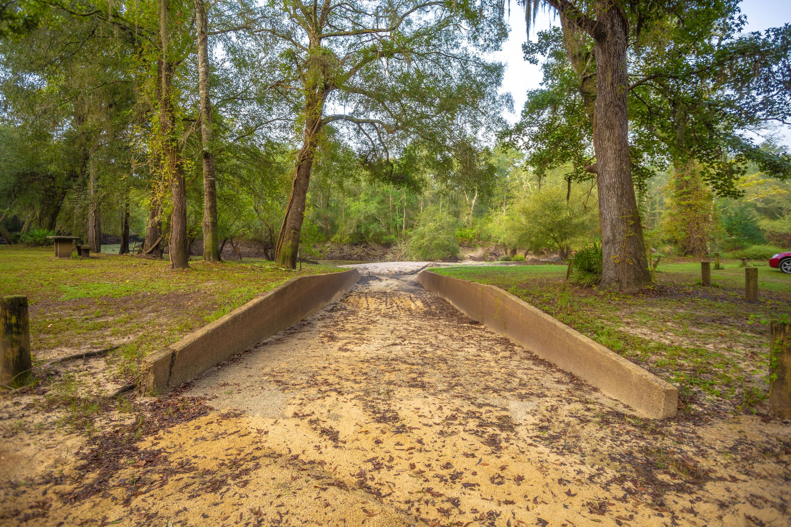An image of a boat ramp leading to a river.