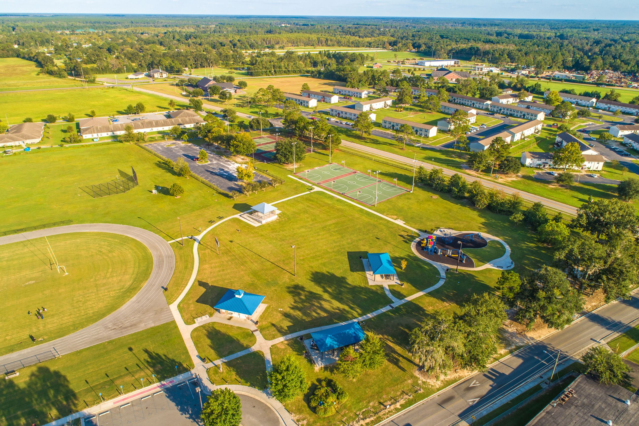 Image showing an aerial view of a park with picnic shelters and playground.