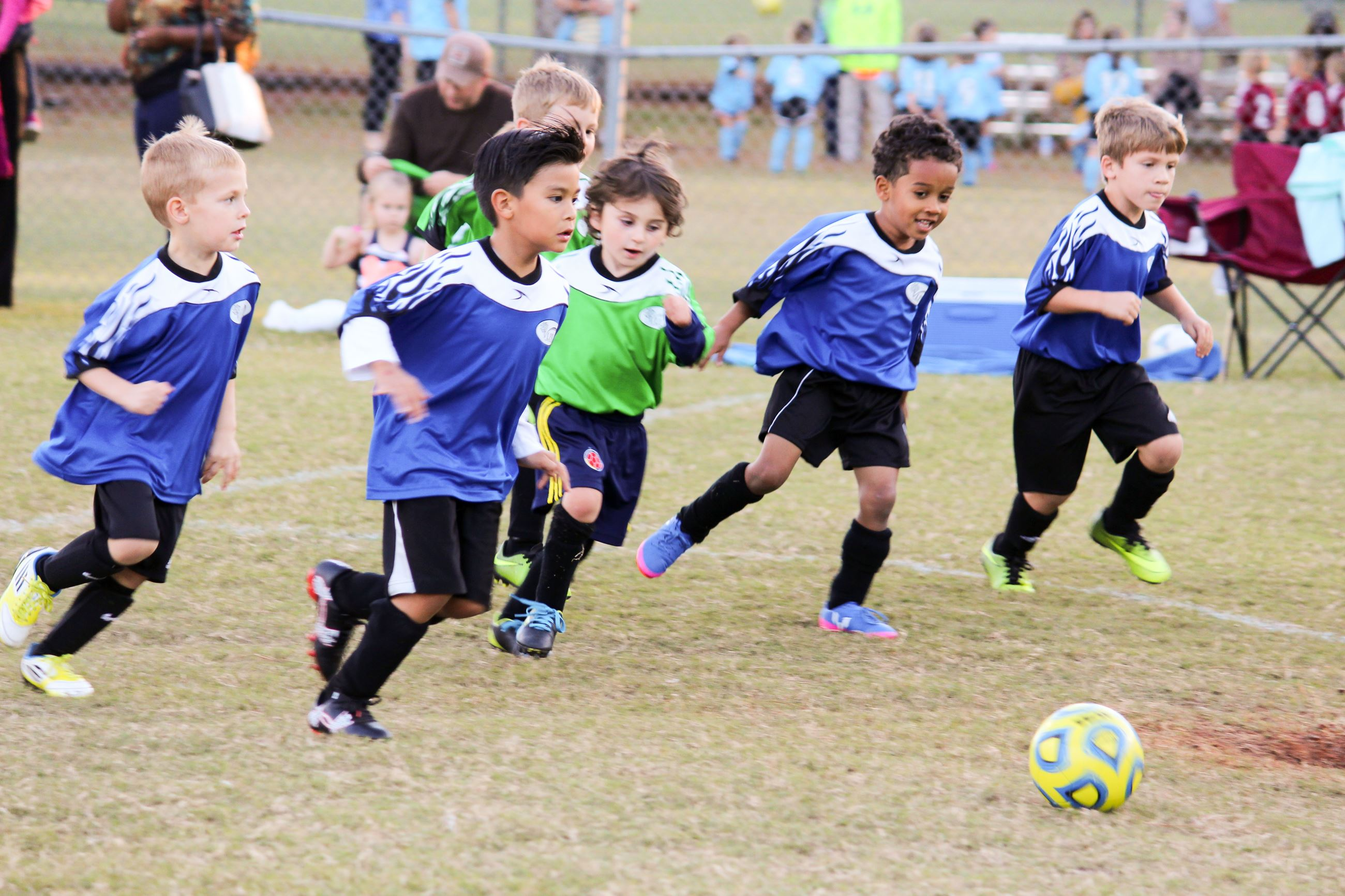 Image of children playing soccer.