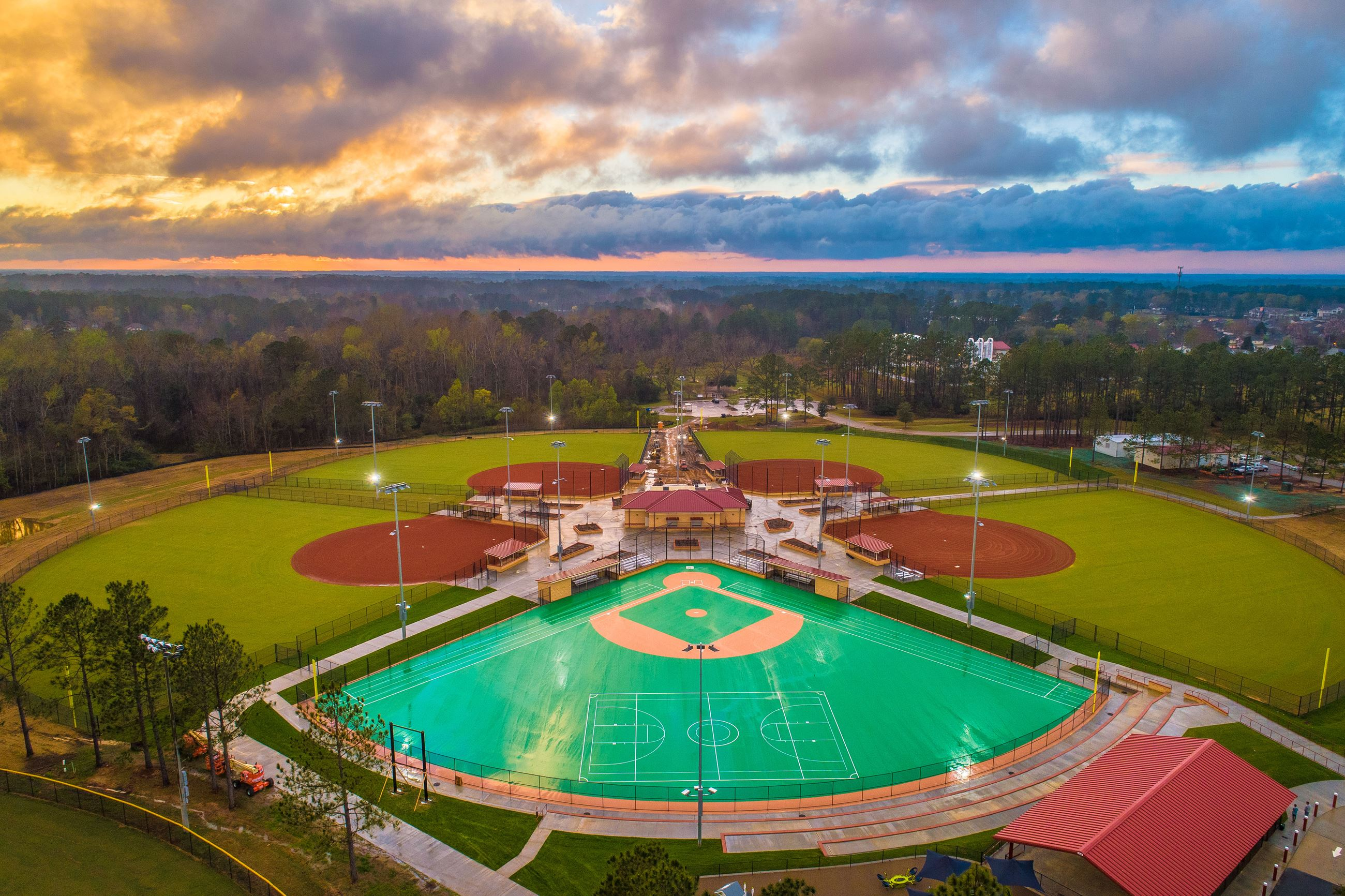 Aerial image of the Miracle Field with a sunset in the background.